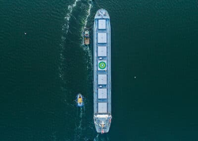 Ultra Lynx at sea with tugboats